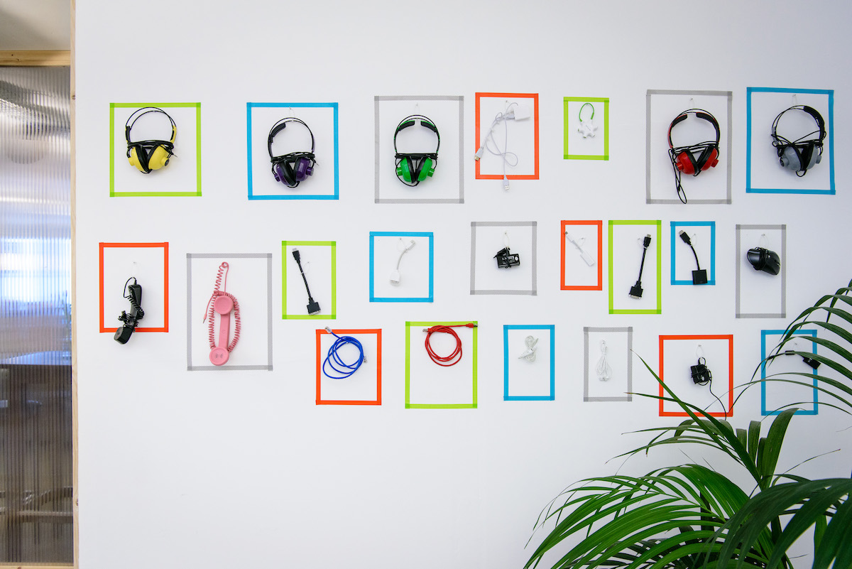 Large wall with useful tools like headphones and adapters